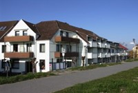 Haus Achtern Diek mit Hafenblick